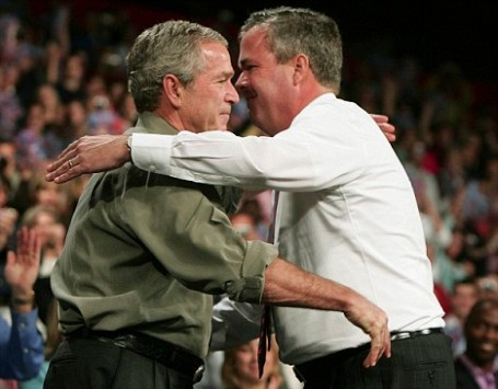 US President Bush hugs his brother Florida Governor Jeb Bush at a Republican party congressional election rally in Pensacola